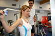 Woman in gym lifting weight