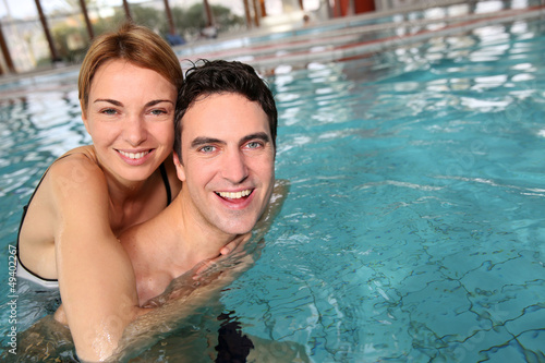 Couple enjoying bathtime in spa resort