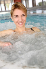 Portrait of woman relaxing in jacuzzi