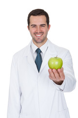 Male Doctor Holding Green Apple