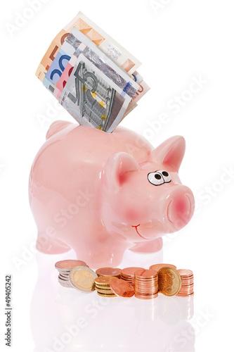 Rosa Sparschwein mit Münzen und Geldscheinen- Pink piggy bank w