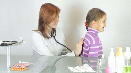 Pediatrician woman listening stethoscope little girl