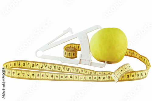 apple, meter and caliper on a white background