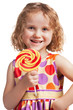 Happy little girl with a lollipop