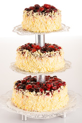 Three-story cake almond with red berries