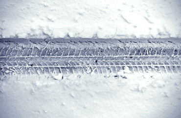 Detail of car's tire track in snow