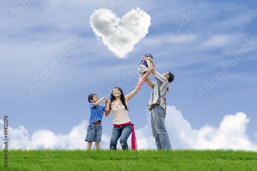 Family have fun under love clouds