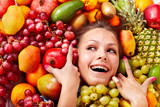 Fototapety Girl in group of fruit.