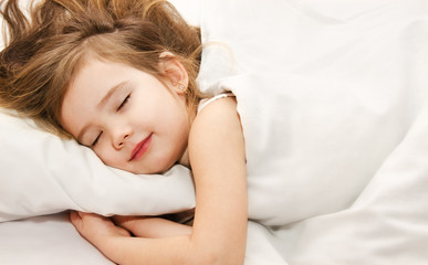 Little girl sleep in the bed close-up