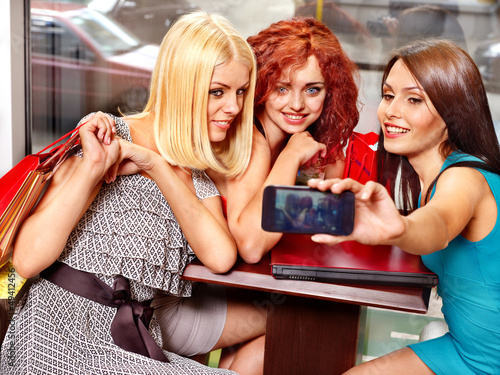 Women at laptop  in a cafe.