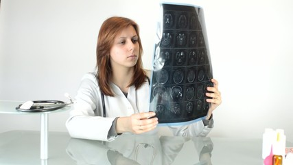 woman doctor carefully considers tomogram