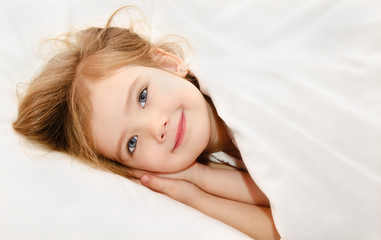 Little girl awaked up in her bed