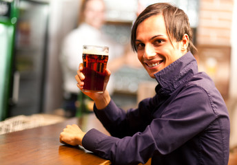 Man drinking a beer in a bar