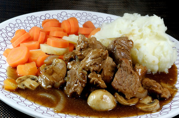 Pork Pieces with Mashed Potatoes and Vegetables