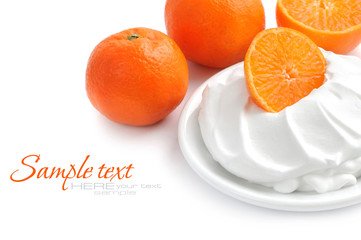 Cream with tangerines on a white background