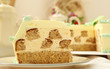 Piece of beige creamy cake with nuts