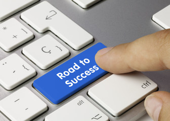 Road to Success keyboard key. Finger