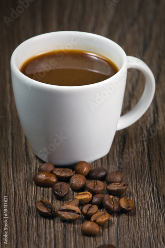 Fotobehang Koffiebonen Cup full of coffee