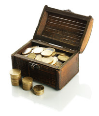 Coins in chest isolated on white