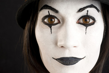 Female in White Face Playing a Clown or Mime