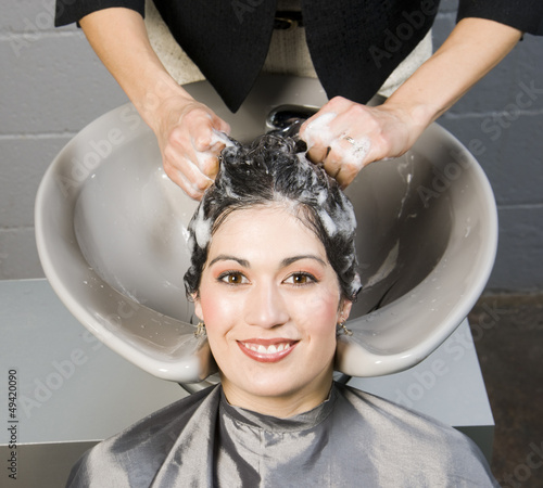 Attractive Woman Gets Spa Salon Shampoo and Conditioning