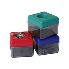 Colorful magnetic plastic boxes, a container of paperclips isola