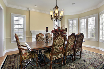 Dining room with white fireplace