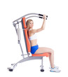 Blonde woman sitting on exerciser
