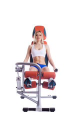 Blonde woman sitting on orange hydraulic exerciser