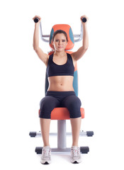 Brunette woman sitting on hydraulic exerciser