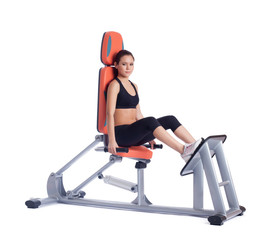 Young brunette woman on orange hydraulic exerciser