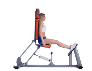 Blonde woman sitting  on isodynamic exerciser