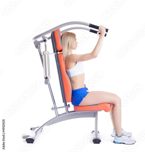 Young woman sitting on orange hydraulic exerciser