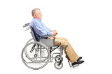 A disabled senior man posing in a wheelchair