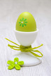 green easter egg in egg-cup