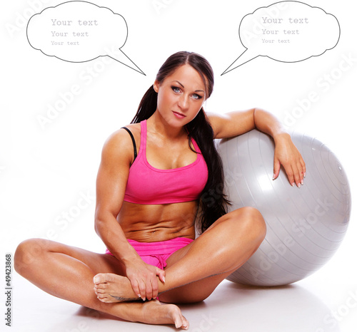 Woman posing with the fitball