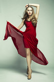 Fototapety Fashion photo of young magnificent woman in red dress