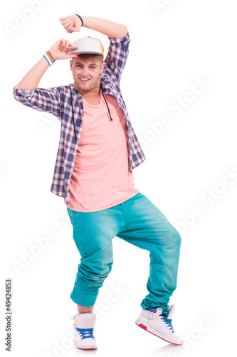 dancer holding his cap & smiling