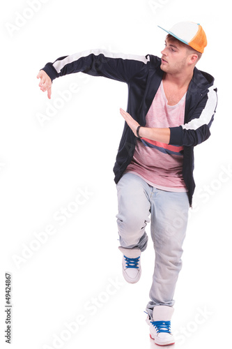 male dancer posing on one leg
