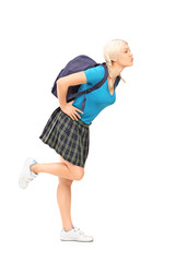 Full length portrait of a female student with school bag giving