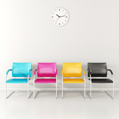 CMYK colored stools in the waiting room
