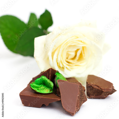 Pieces of chocolate bar with white rose