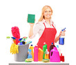 Mature female cleaner posing with cleaning equipment