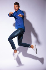 man jumping & pointing
