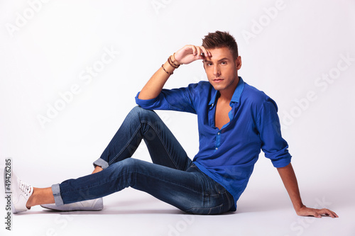man sitting on floor looking at you