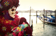 Clown with gondola and puppet in Venice