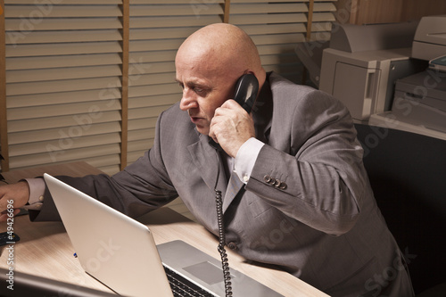 businessman talks by phone