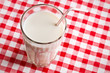 glass of milk on checkered tablecloth