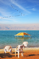 The Dead Sea, beach umbrellas and deckchairs
