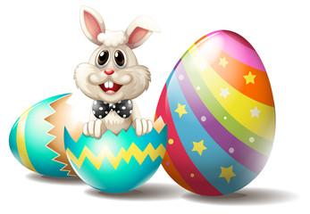 A rabbit inside a cracked easter egg